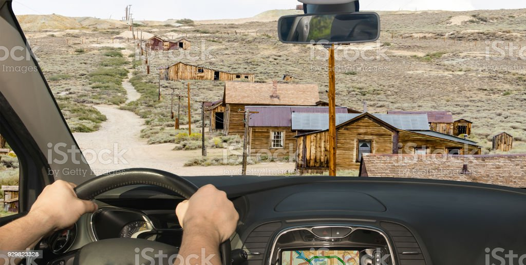 Driving a car in ghost town of Bodie, California, USA stock photo