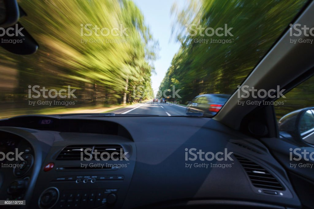 Driving a car in good weather conditions stock photo