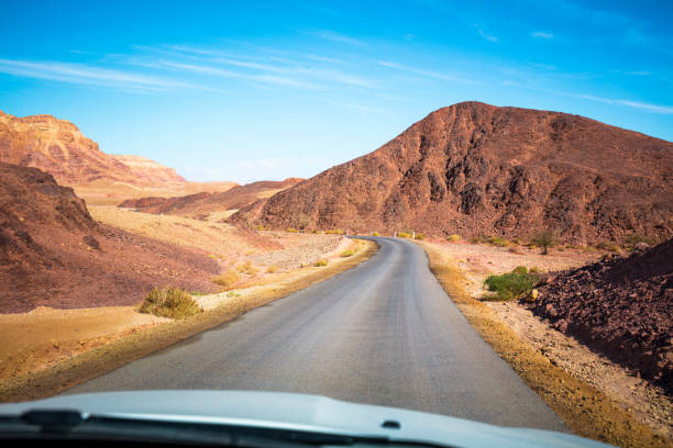 Driving a car on a mountain road. Driving a car on a mountain road. negev stock pictures, royalty-free photos & images