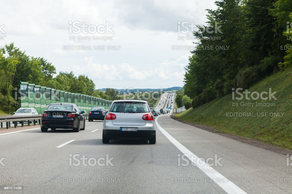 Driving a car on the highway in good weather conditions stock photo