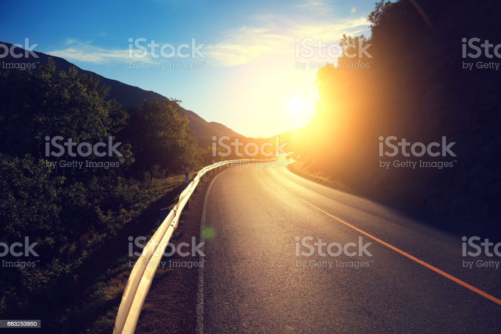 Driving a car on the mountain winding road at sunset. Nature Norway. royalty-free 스톡 사진
