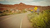 Driving a car on desert highway POV