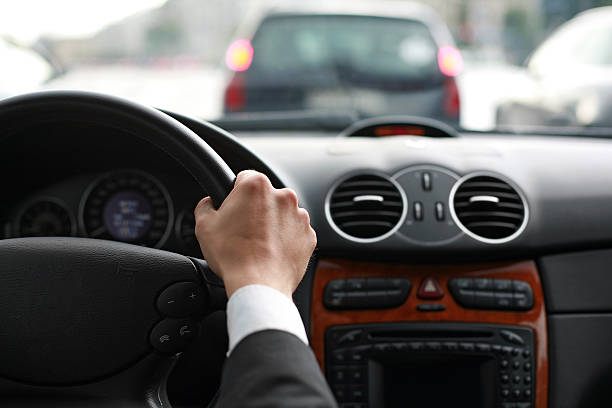 driving a car - steering wheel stock photos and pictures
