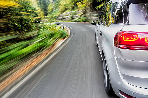 driving a car - generic location stock pictures, royalty-free photos & images