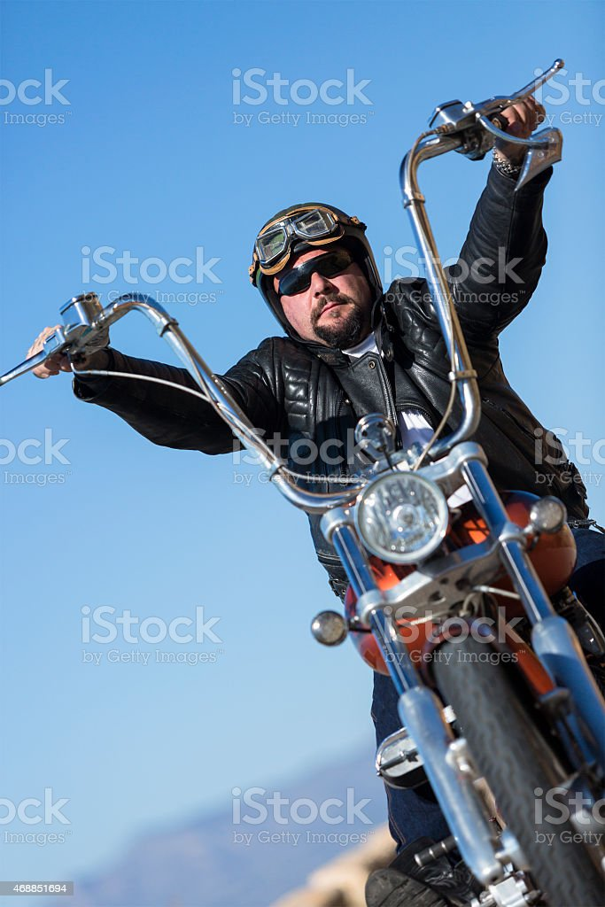 driving a customized motorcycle stock photo