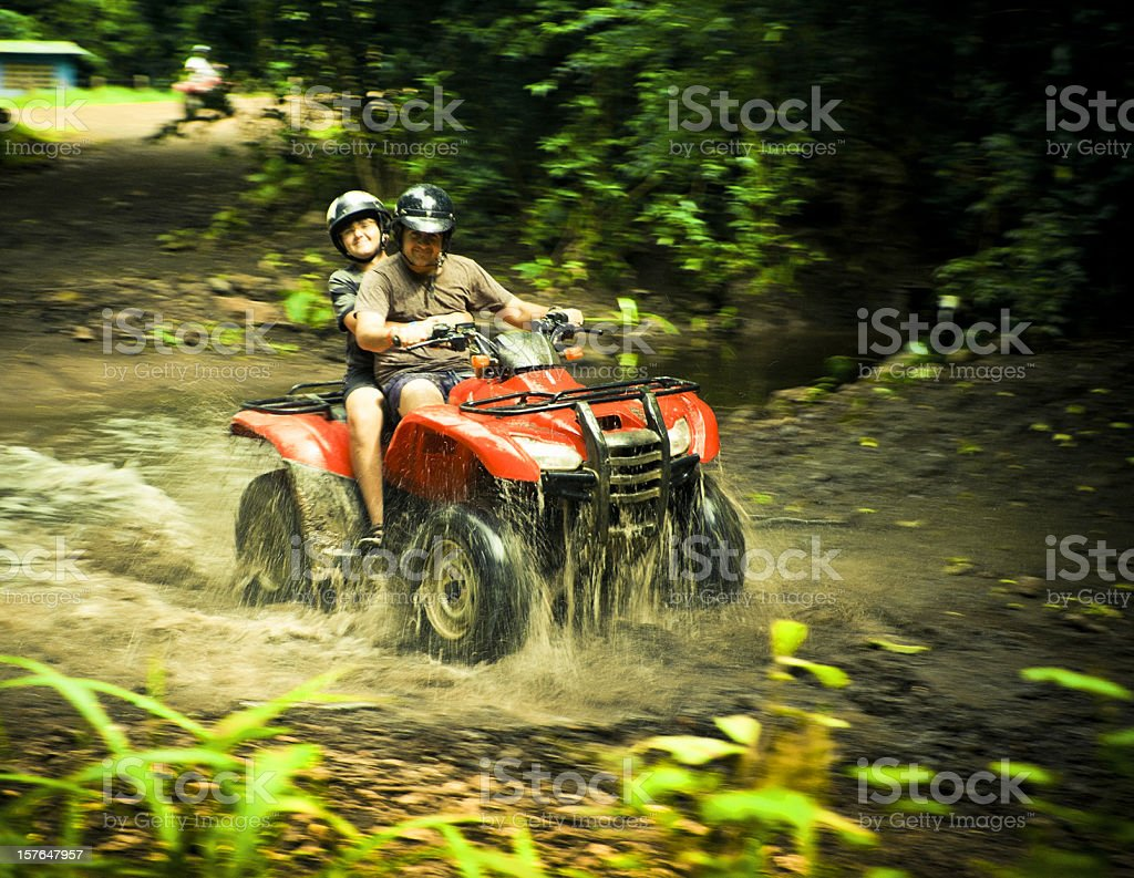 driving a four wheeler in costa rica royalty-free stock photo