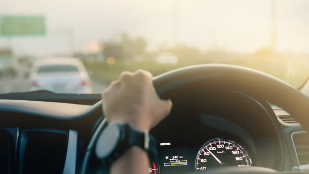 Driving a modern car on the road. stock photo