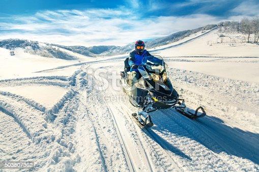 Man driving a snowmobile in Colorado, USA