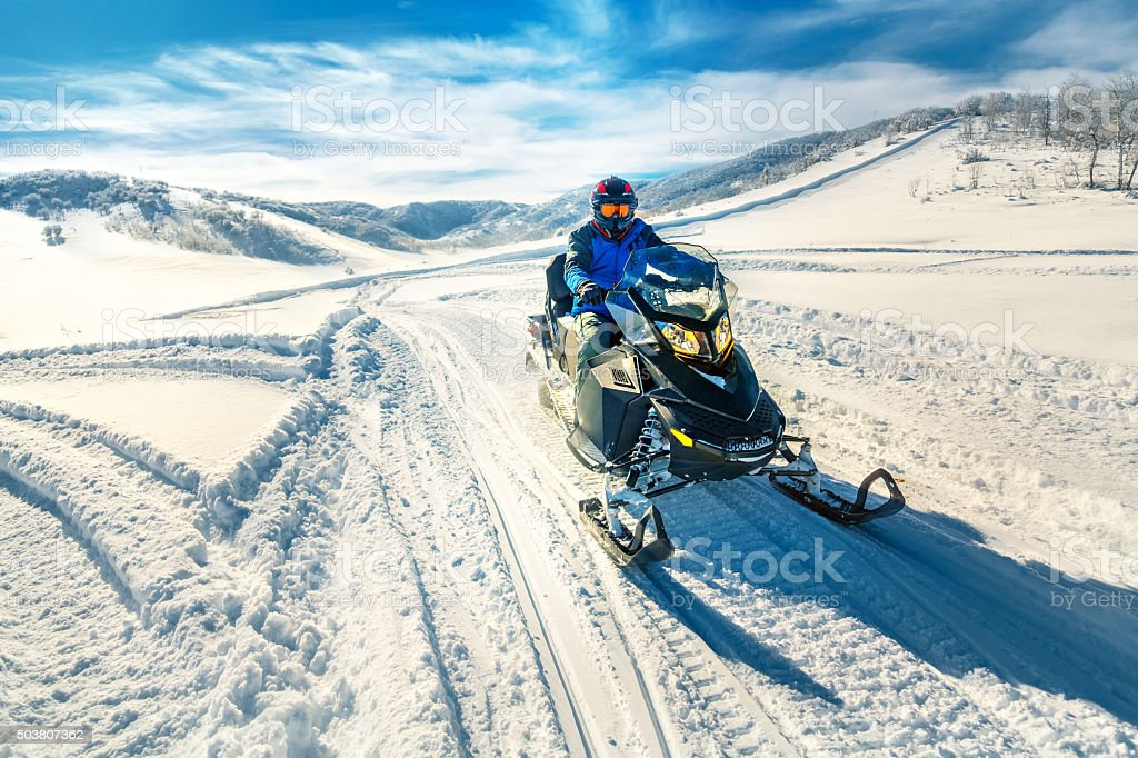 Driving a snowmobile stock photo
