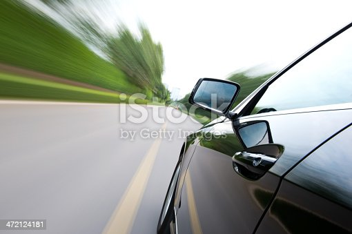 688980174istockphoto driving along country road 472124181
