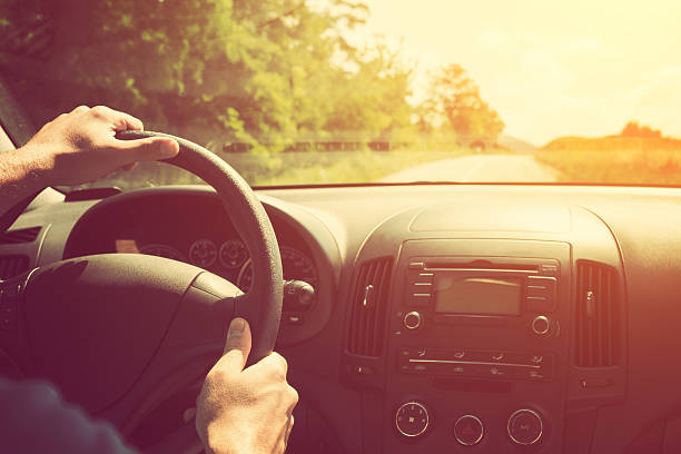 Driving and holding the steering wheel. stock photo
