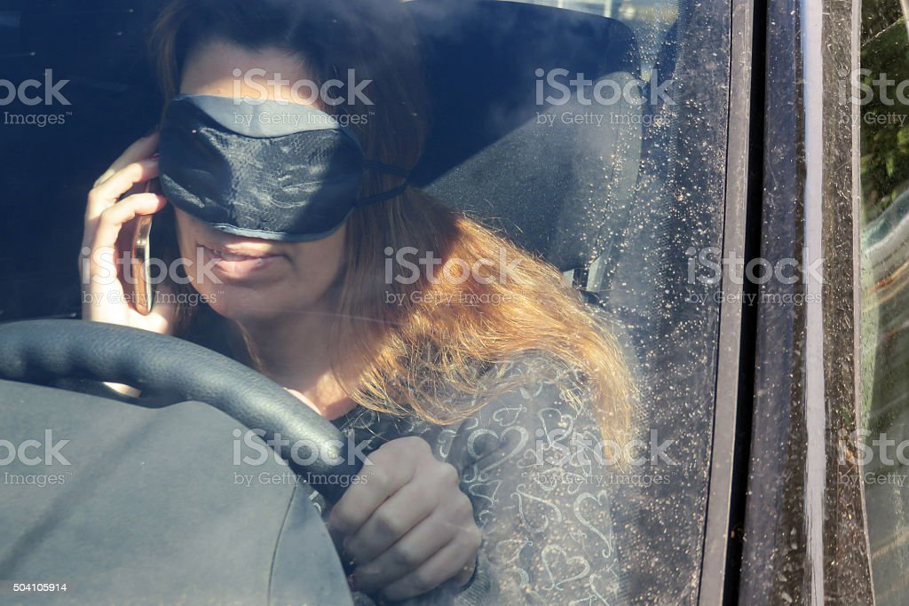 Driving and talking on the phone stock photo