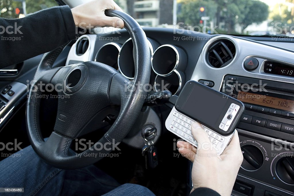 Driving and Texting in a Car royalty-free stock photo