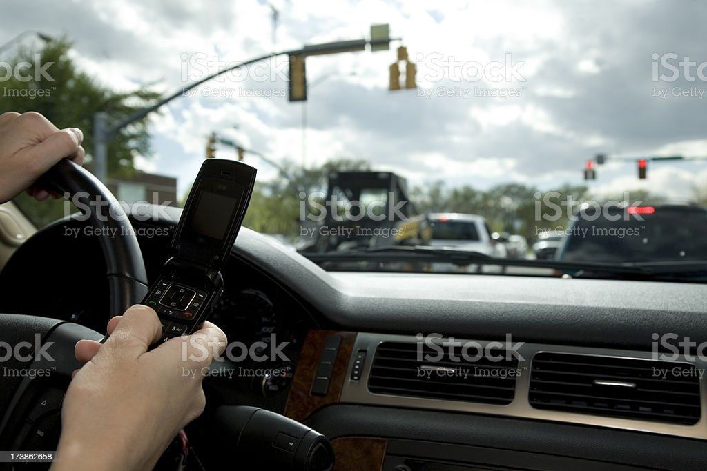 Driving and Texting royalty-free stock photo