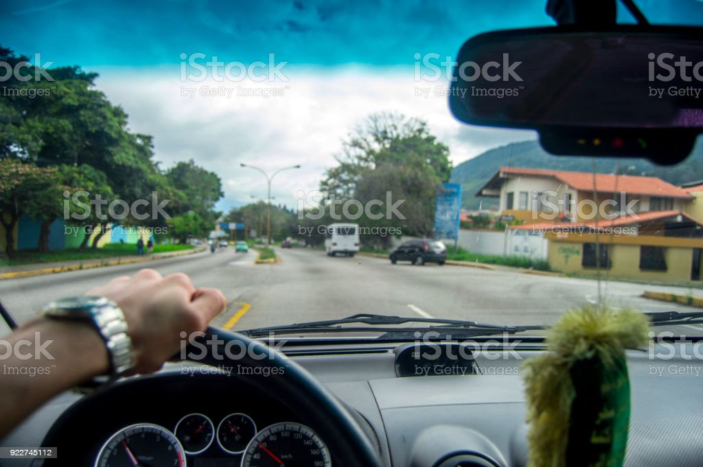 Driving at day, view house and cars stock photo