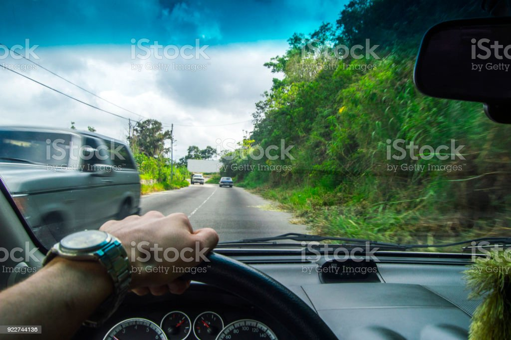 Driving at day, view into the green nature closely cars stock photo