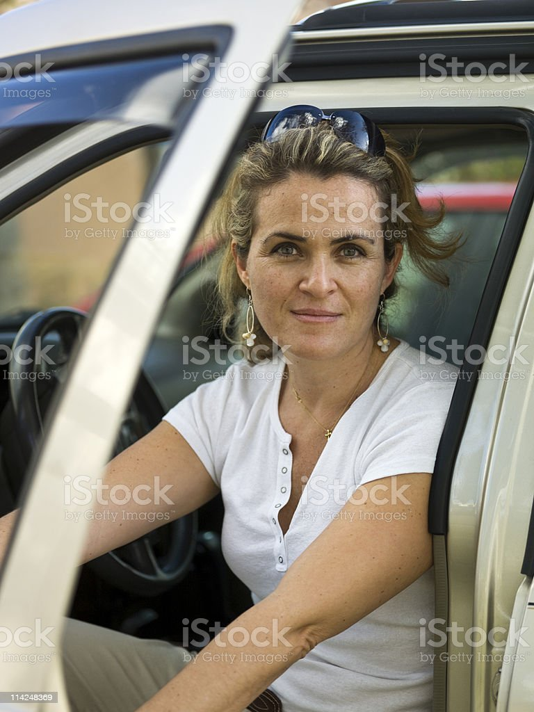 Driving at her forties royalty-free stock photo