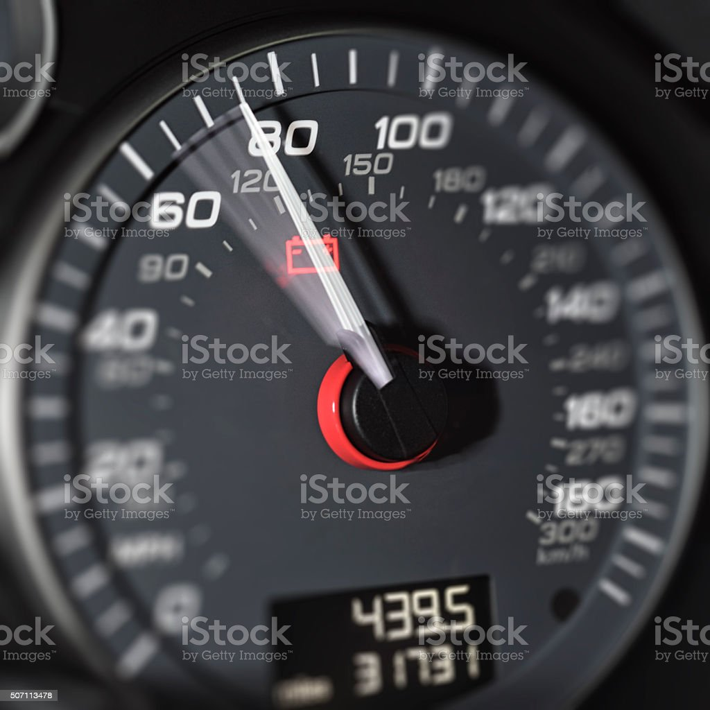 Driving at high speed - rising speedometer needle stock photo