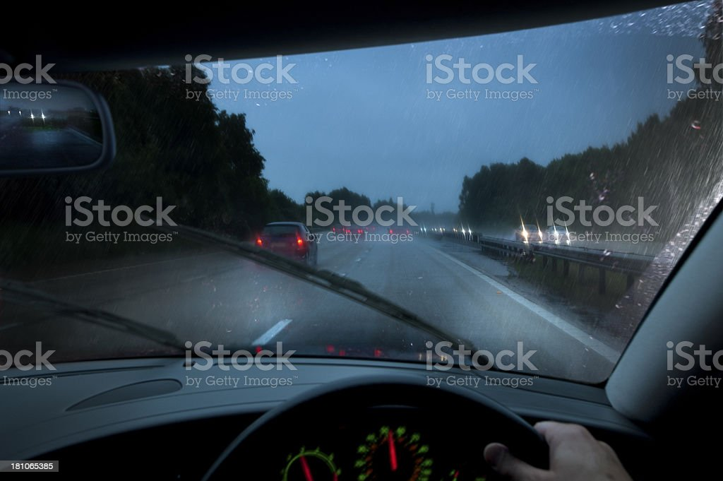 Driving at night in heavy rainstorm stock photo