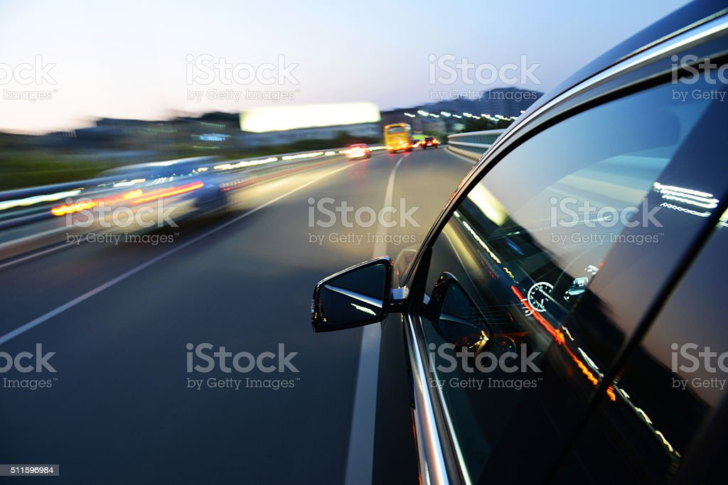Driving at night stock photo