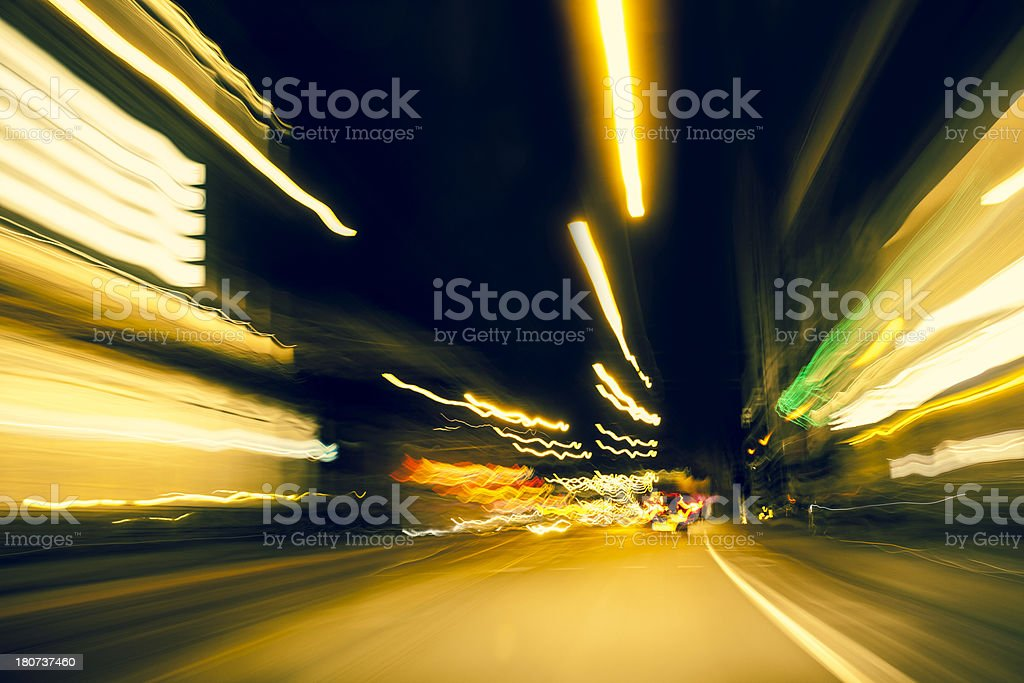 Driving at night with abstract city light trails, Amsterdam royalty-free stock photo
