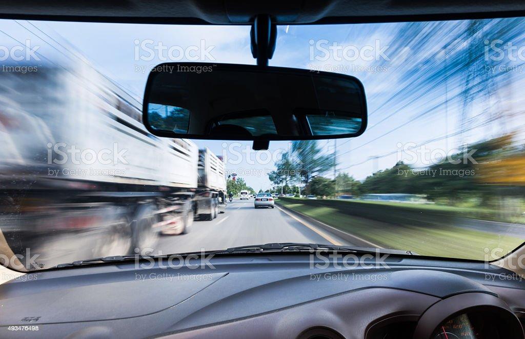 Driving at speeds near large trucks . stock photo
