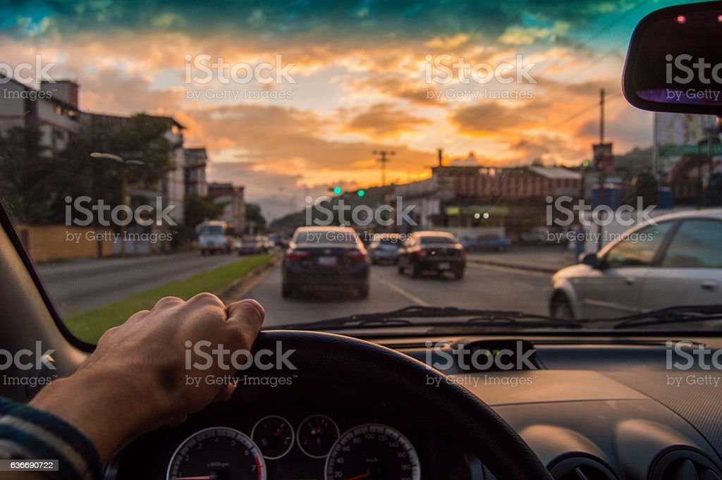 Driving at sunset. View from the driver angle,car focusinside royalty-free stock photo