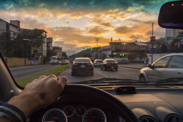 Driving at sunset. View from the driver angle,car focusinside stock photo