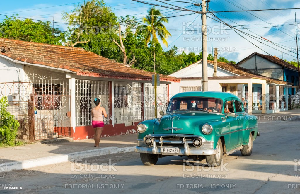 Driving blue green american Chevrolet classic car on the street in the suburb from Havana City Cuba - Serie Cuba Reportage stock photo