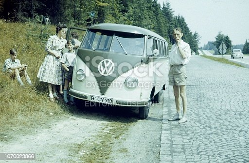 Lower Saxony, Germany, 1959. A family interrupts their journey to take a break.