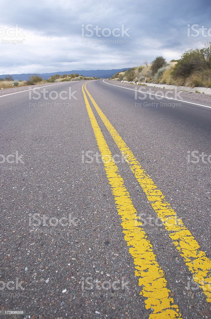 Driving by a desert road (andes) royalty-free stock photo