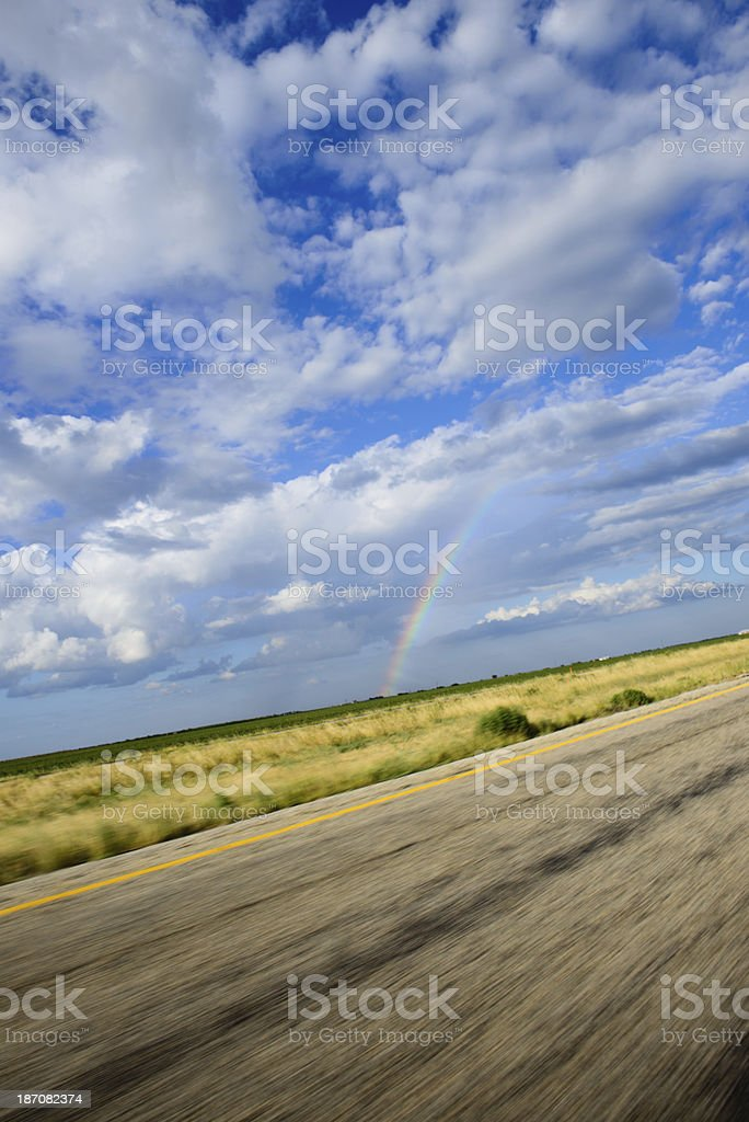 Driving By A Rainbow - Vertical royalty-free stock photo