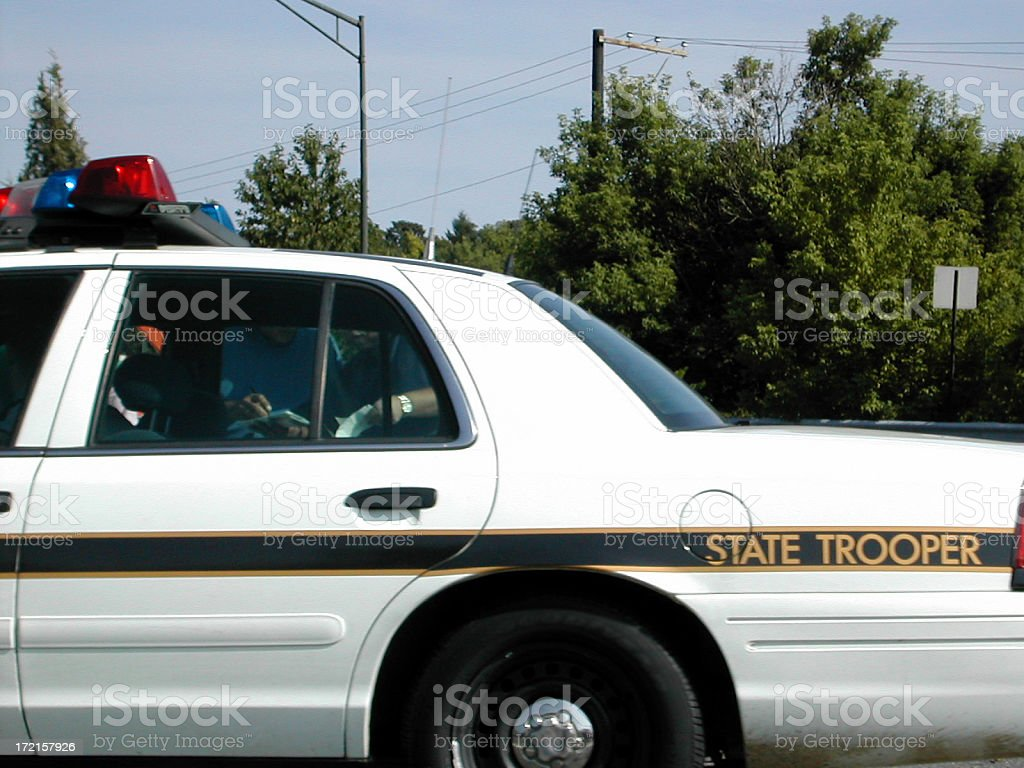 driving by a state trooper stock photo