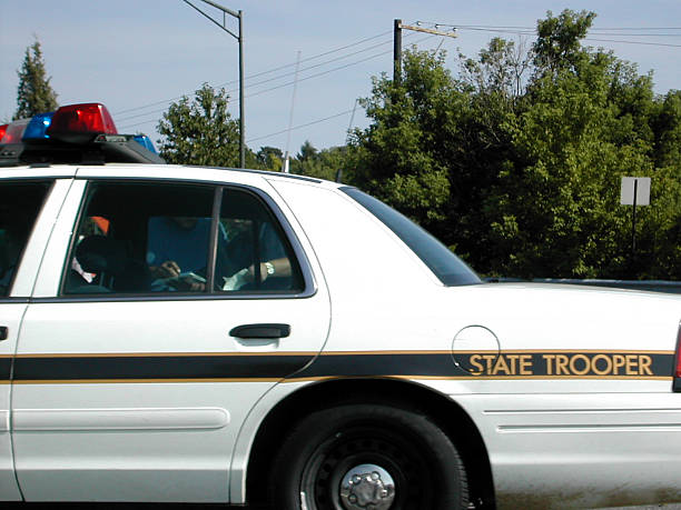"""driving by a state trooper """"i hate rubber neckers, traffic was moving so slow, i was able to get the camera out and take this."""" trooper stock pictures, royalty-free photos & images"""