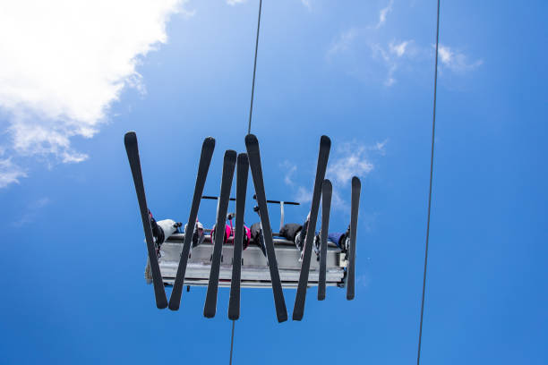 Driving by cable car on the mountain Group of people driving by cable car on the mountain, low angle view apres ski stock pictures, royalty-free photos & images