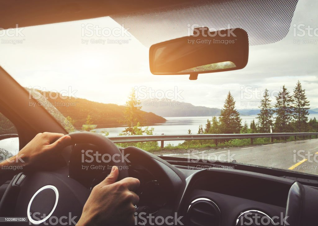 driving car in Norway, road trip stock photo
