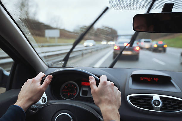 driving car in rainy day driving in hard weather conditions, rain on the windshield windshield wiper stock pictures, royalty-free photos & images