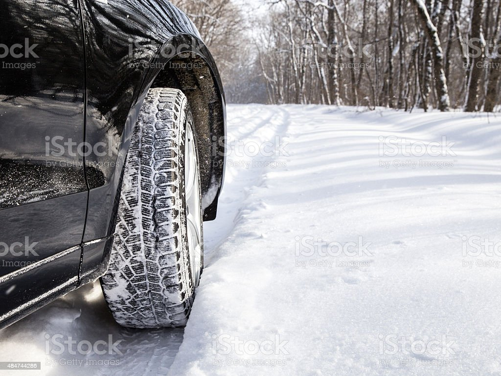 Driving car in winter with much snow stock photo