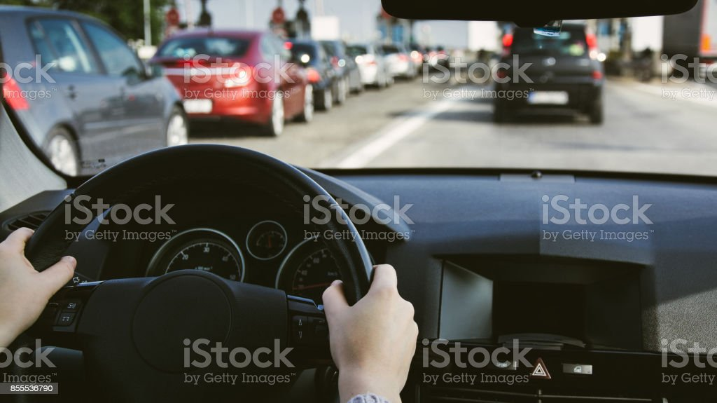 Driving car on the road. Hands on steering wheel inside of a car stock photo