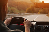 istock driving car on the road, travel background 1214872234