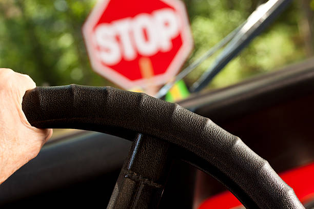 driving car stopped at construction or school crossing stop sign. - stop sign stock pictures, royalty-free photos & images