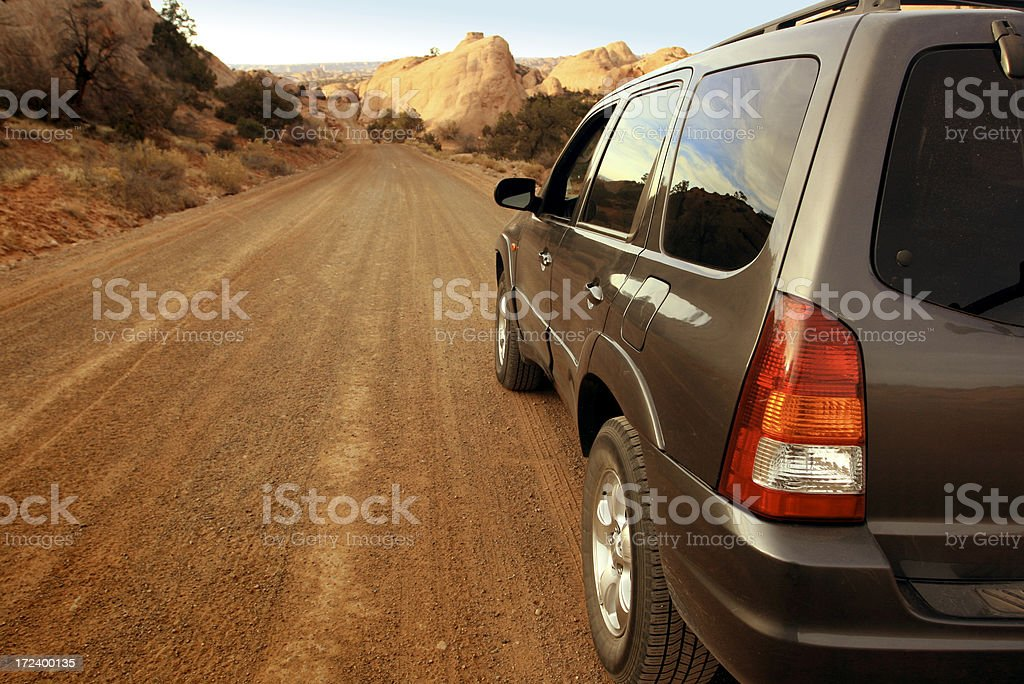 Driving Down Dirt Road stock photo