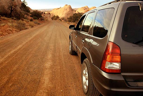 Driving Down Dirt Road stock photo