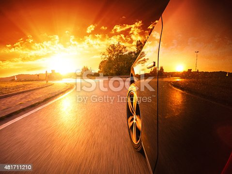 688980174istockphoto Driving fast at sunset 481711210