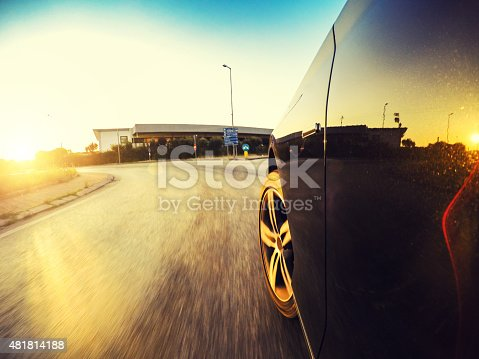 688980174istockphoto Driving fast at sunset 481814188