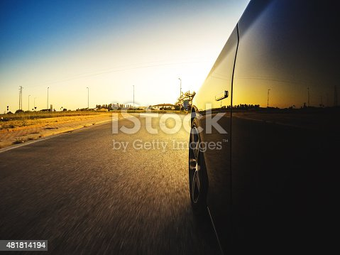 688980174istockphoto Driving fast at sunset 481814194