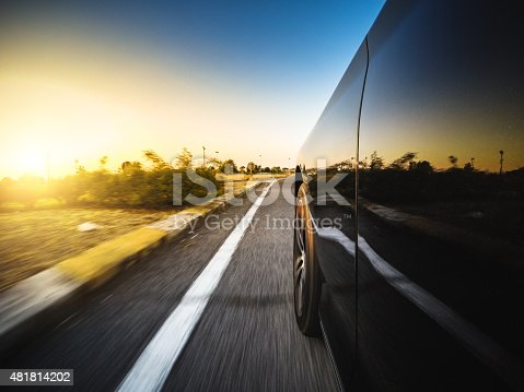 688980174istockphoto Driving fast at sunset 481814202