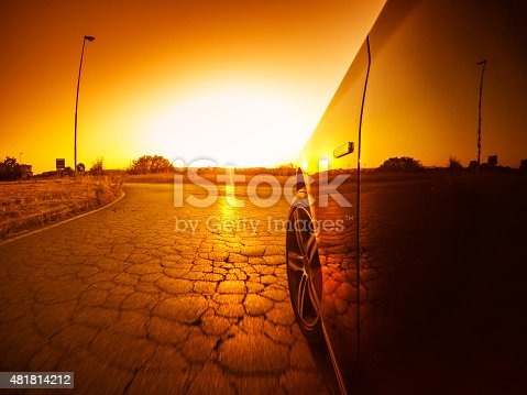 688980174istockphoto Driving fast at sunset 481814212