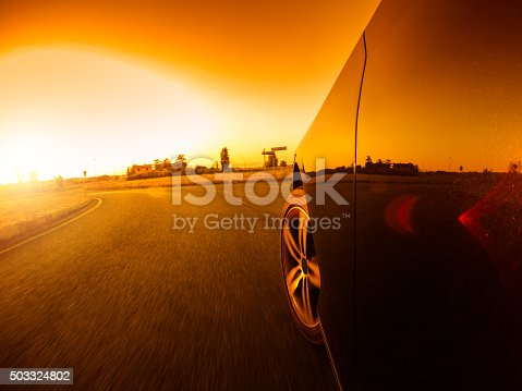 688980174istockphoto Driving fast at sunset 503324802