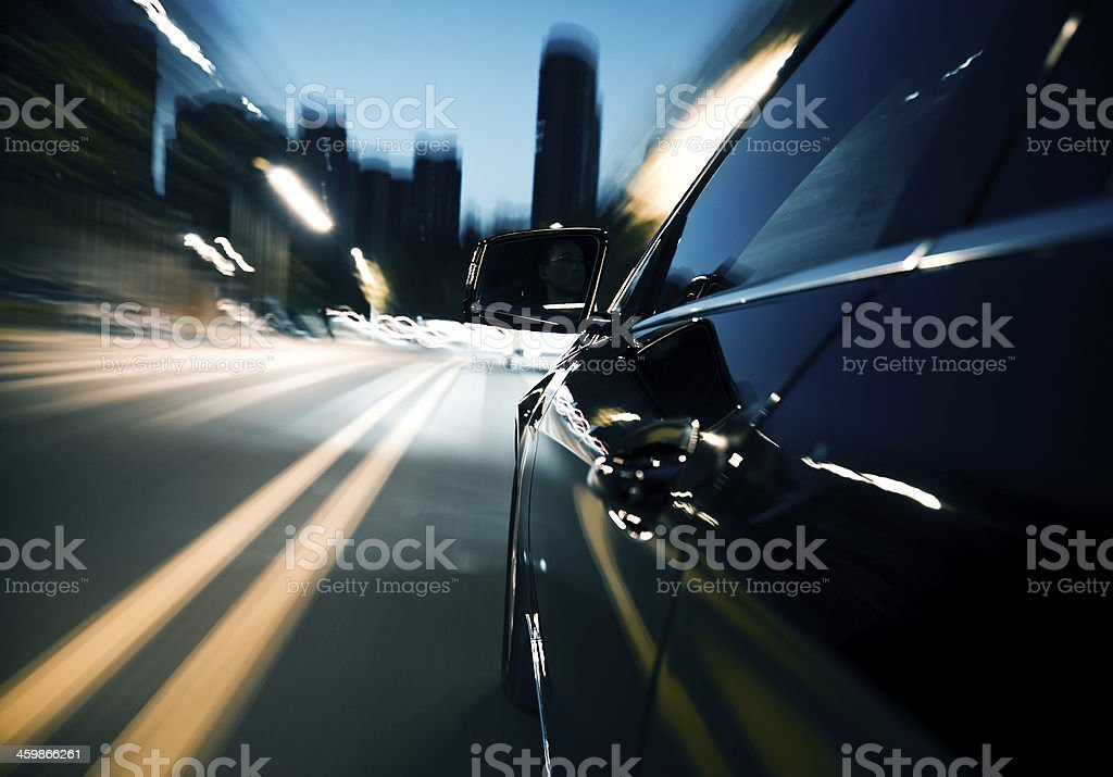 Driving fast in the city at night stock photo